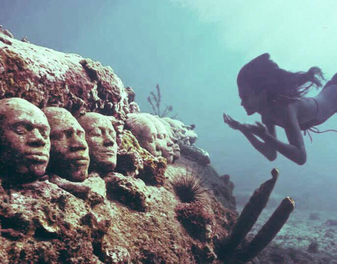 Mermaid swimming at the bottom of the sea
